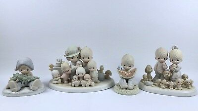 Lot of 4 Precious Moments Figurines 12440,521515,522112,114022