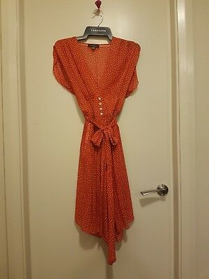Cute womens designer red poka dot dress with pockets size 6 - 8. Great condition