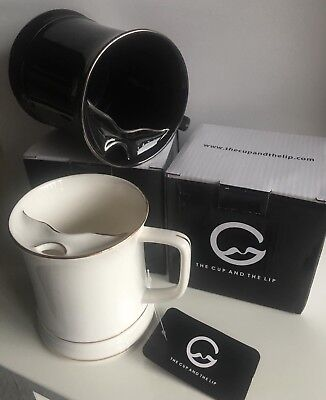 "The Cup and The Lip ""LipMaster"" mustache cup coffee mug—Black with Silver trim."