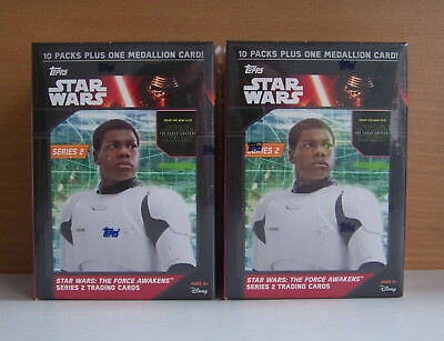 Two sealed boxes Star Wars Force Awakens each box 10 packs 1 medallion. Series 2