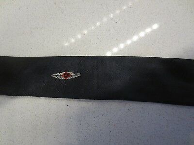 Groovy original black vintage super-skinny tie with red, white and black motif