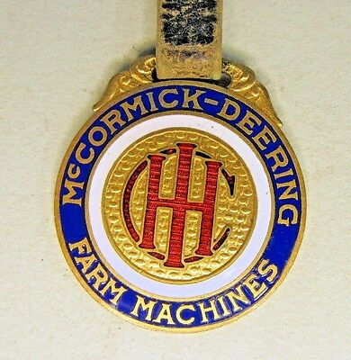 early enamel inlaid I-H IHC McCORMICK DEERING Lewisville MN original watch fob
