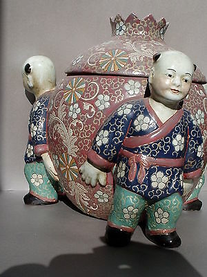 Oriental Pottery Urn Majolica, Globe Shaped, Carried By Three Male Figurines
