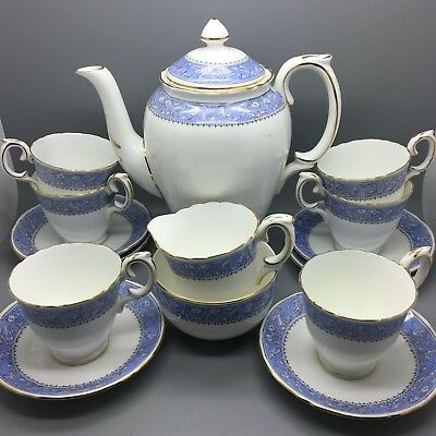 "Crown Staffordshire ""Cameo"" floral & Cherub bone china coffee set - 15 pieces."