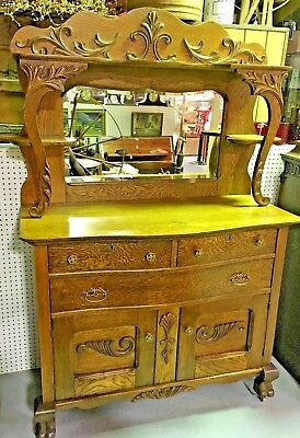 Antique Tiger Oak Victorian Sideboard Buffet with Beveled Mirror caster wheels