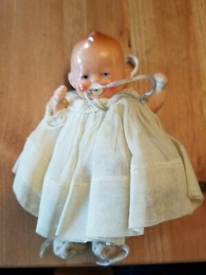 Composition jointed Baby Doll with Pacifier in Original clothing Vintage