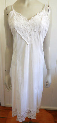 Glamorous vintage lacey cream full slip with gathered back skirt size 12 - 14