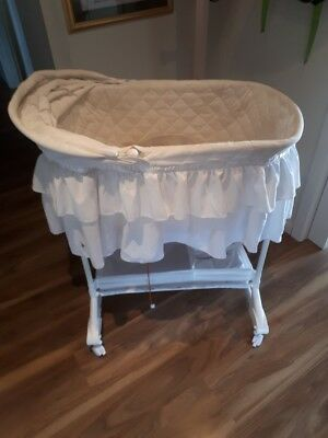 baby bassinet with hood and music arm