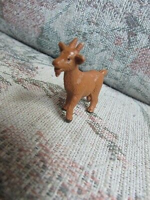 "Small Brown Plastic Goat, approx 2"" big"