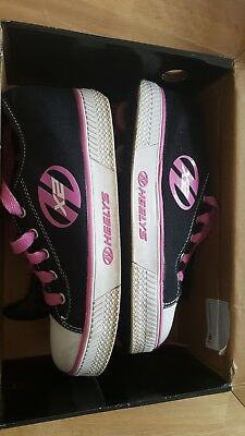 Heelys, size 5 black and pink, used but good condition.