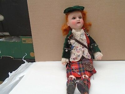antique Arthur Schoenau Hoffmeister doll with scottish costume & sleeping eyes
