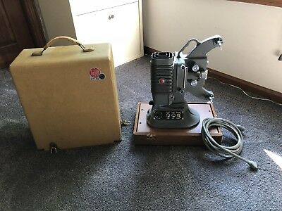 DeJUR Model 750 Movie Projector with power cord & case.