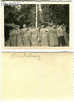 Vintage Photo circa 1940s rear view from young german women in uniforms,flag