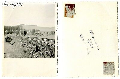 Vintage Photo circa 1930s young man alone walking away on train rails,landscape