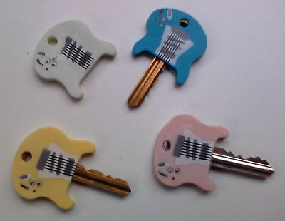 4 x Colourful Guitar Key Cap Covers. Plastic FREE POSTAGE