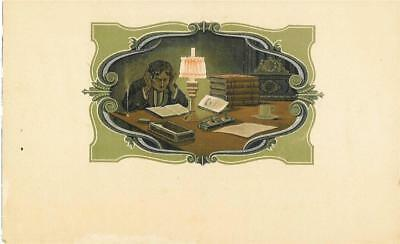 man at desk inkwell lamp clock matches cup  cigar label