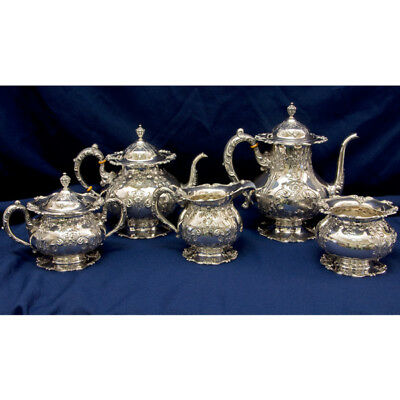 Frank M. Whiting 5 piece hand chased with gold gild sterling silver tea set...