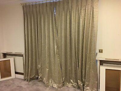 Good quality pair of curtains in goldy beige body with contrasting floral motif