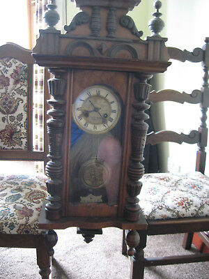 Old striking pendulum clock