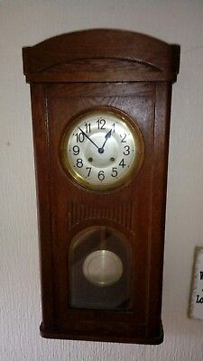 Lovely ting tang wall clock with 5 chime rods