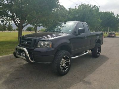 2004 Ford F-150 STX 2004 Ford F-150 stx lifted 20 inch rims with mud wrapplers purple sound system