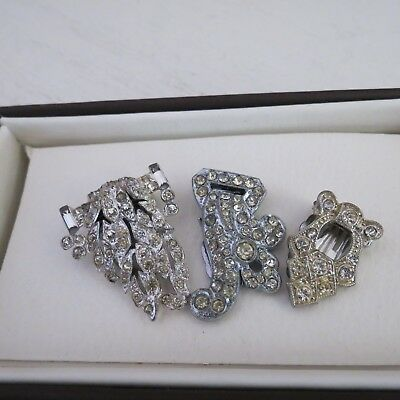 Three  vintage silver tone metal dress clips with clear diamantes