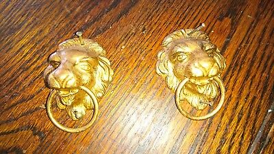 antique clock parts lions x 2. Black mantel clock side decorations. Metal