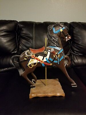 Hand cut and carved horse carousel