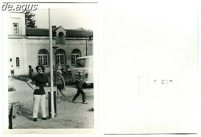 Vintage Photo circa 1960s young woman with sunglasses, mini bus transport