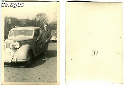 Vintage Photo circa 1950s young Man with classic car,vw beetle volkswagen