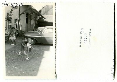 Vintage Photo circa 1960s two little boys playing , cars