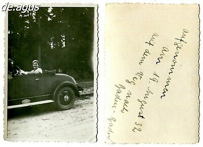 Vintage Photo from 1932 young woman driving convertible opel car