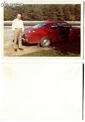 Vintage color Photo circa 1970s Man with red opel car