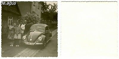 Vintage Photo circa 1960s Family posing with vw beetle volkswagen
