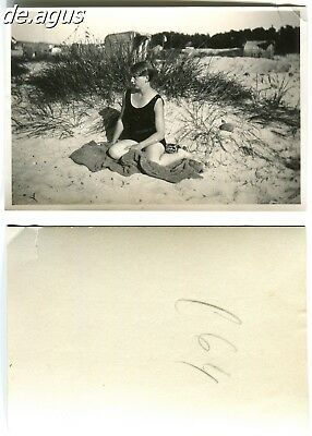 Vintage Photo circa 1930s young woman in swimsuit sitting on the sand