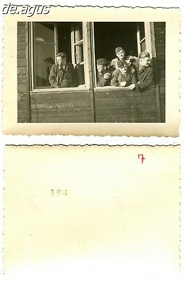 Vintage Photo 1940s young german soldiers  looking through the window of house