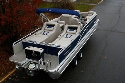 New-2785 rear lounge pontoon boat with 60 four stroke mercury and a dual bunk tr
