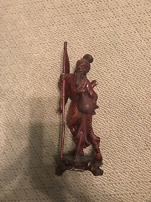 asian carved wood statue