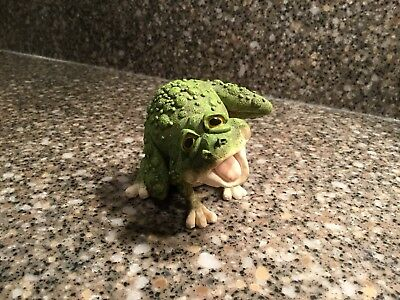 "Frog Sitting on Golf Ball, measures 2.5"" tall.  Unmarked and in excellent"
