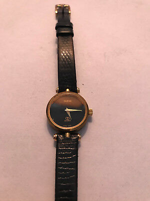 21f9fa19fcb Women s Vintage Gucci Watch - Black Leather Band with Gold Accents Round  Face
