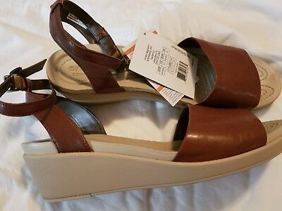 ce344706125e Crocs Women s Leigh-Ann Ankle Strap Leather Wedge Sandal - Brown Size 11