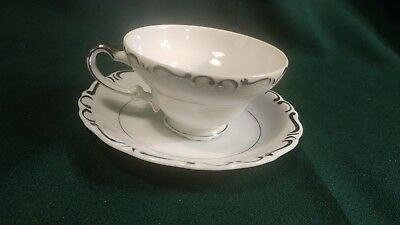 **VINTAGE** Ucagco China Heirloom White with Silver Trim Teacup & Saucer