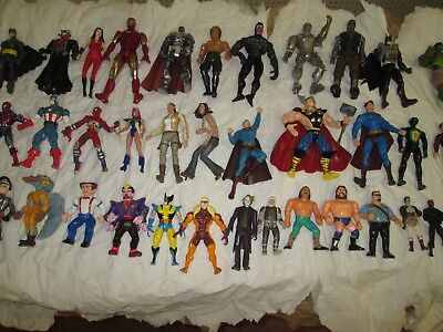 mixed lot of 40 vintage action figures DC Marvel horror Star wars and more.