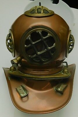 Vintage miniature copper and brass diver's helmet; 7 inches tall