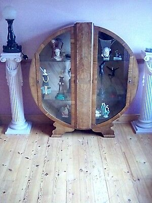A lovely Original round art deco light oak display cabinet in great condition