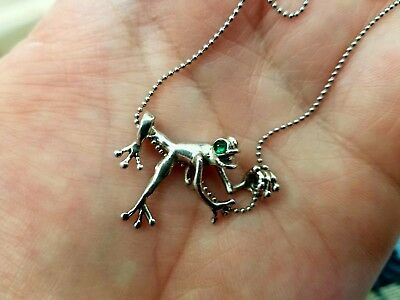 Sterling silver frog with emerald eyes necklace