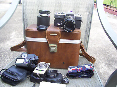 Minolta SRT-100 35mm SLR Film Camera with 2 lens. 2 light bars original strap.