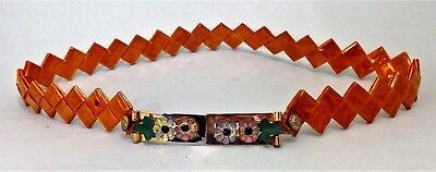 Vintage 40's celophane belt with gold coloured buckle and metal applied flowers