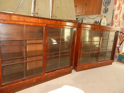 A pair of Edwardian bookcases with sliding glazed doors