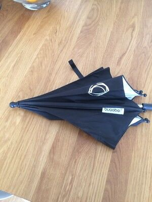 Black bugaboo sun parasol with clip for Bee . Hardly used.